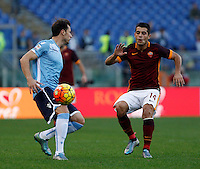 Calcio, Serie A: Roma vs Lazio. Roma, stadio Olimpico, 8 novembre 2015.<br /> Lazio's Stefan Radu, left, is challenged by Roma's Iago Falque during the Italian Serie A football match between Roma and Lazio at Rome's Olympic stadium, 8 November 2015.<br /> UPDATE IMAGES PRESS/Isabella Bonotto