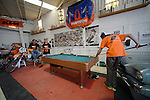 BAJA CALIFORNIA, MEXICO - NOVEMBER 14:  Crew Members of the FMF/Bonanza Plumbing KTM team play pool in the KTM Shop on November 14, 2013 in Baja California, Mexico. (Photo by Donald Miralle for ESPN the Magazine) *** Local Caption ***Kurt Casselli