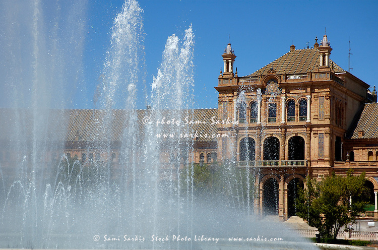 Water fountain on the Plaza de Espana, Seville, Andalusia, Spain.