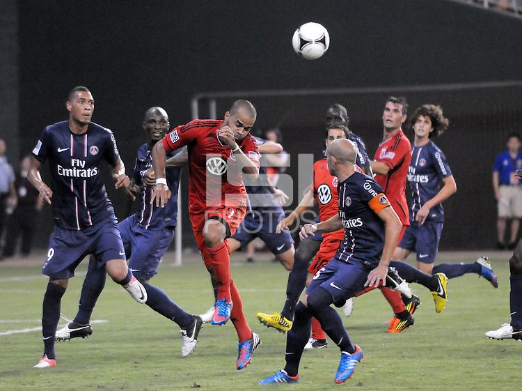 D.C. United forward Maicon Santos (29) heads the ball. D.C. United tied Paris St. Germain 1-1 at RFK Stadium, Saturday 28, 2012.