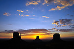 Sunrise at the Mittens in Monument Valley Navajo Tribal Park.