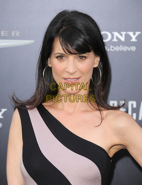 Perrey Reeves.Premiere of 'Total Recall' held at The Grauman's Chinese Theatre in Hollywood, California, USA..August 1st, 2012.headshot portrait beige silver hoop earrings pink lilac black striped stripes one shoulder  .CAP/RKE/DVS.©DVS/RockinExposures/Capital Pictures.
