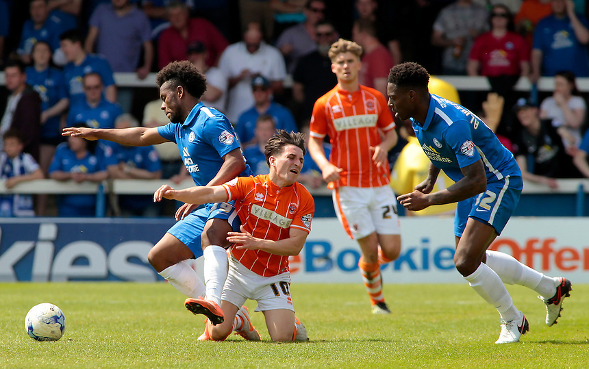Blackpool's Jack Redshaw is tackled by Peterborough United&rsquo;s Shaquile Coulthirst<br /> <br /> Photographer David Shipman/CameraSport<br /> <br /> Football - The Football League Sky Bet League One - Peterborough United v Blackpool  - Sunday 8th May 2016 - ABAX Stadium - London Road   <br /> <br /> &copy; CameraSport - 43 Linden Ave. Countesthorpe. Leicester. England. LE8 5PG - Tel: +44 (0) 116 277 4147 - admin@camerasport.com - www.camerasport.com