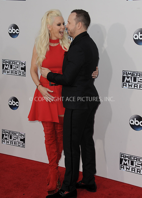 WWW.ACEPIXS.COM<br /> <br /> November 22 2015, LA<br /> <br /> Jenny McCarthy and Donnie Wahlberg arriving at the 2015 American Music Awards at the Microsoft Theater on November 22, 2015 in Los Angeles, California.<br /> <br /> By Line: Peter West/ACE Pictures<br /> <br /> <br /> ACE Pictures, Inc.<br /> tel: 646 769 0430<br /> Email: info@acepixs.com<br /> www.acepixs.com