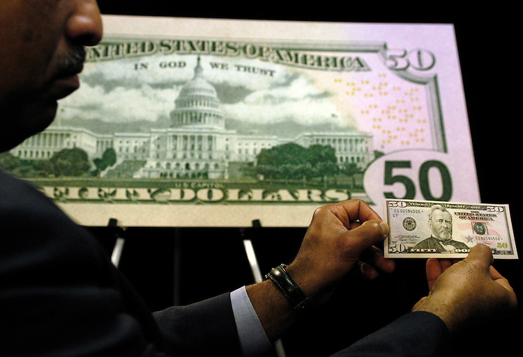 The Department of the Treasury and the Federal Reserve unveilled the new design for the 50 dollar bill. Larry Felix, Assistant Director, Bureau of Engraving and Printing, takes questions about the new security designs to prevent counterfiting. It will begin circulation in the late fall.