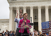 United States Senator Jeff Merkley (Democrat of Oregon), left, and US Senator Elizabeth Warren (Democrat of Massachusetts), right speak at the Anti-Kavanagh protest outside the the United States Supreme Court in Washington, DC as the US Senators continue their floor statements across the street inside the US Capitol on Saturday, October 6, 2018. <br /> Credit: Ron Sachs / CNP<br /> RESTRICTION: NO New York or New Jersey Newspapers or newspapers within a 75 mile radius of New York City)