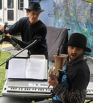 Patrick Wadden and Eli Winograd, of the Arm-of-the-Sea Theater, preparing for a performance on the Bandstand Stage at the 27th Annual Hudson Valley Garlic Festival, held in Cantine Memorial Field, in Saugerties, NY, on Saturday, October 1, 2016. Photo by Jim Peppler; Copyright Jim Peppler 2016.