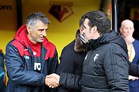 (L-R) Joao Mario Ferreira Oliveira greets Watford manager Marco Silva during the Premier League match between Watford and Swansea City at the Vicarage Road, Watford, England, UK. Saturday 30 December 2017