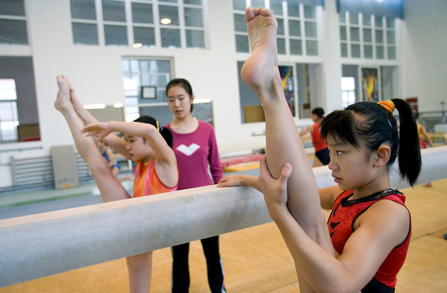 Young girls warm up before an afternoon training session of the Beijing gymnastic team in Beijing.