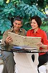 Hispanic couple lookig at a photo album