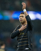 Emilio Izaguirre of Celtic shows appreciation to the support during the UEFA Champions League GROUP match between Manchester City and Celtic at the Etihad Stadium, Manchester, England on 6 December 2016. Photo by Andy Rowland.