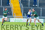 St Brendans Andrew Barry off loads the ball to team mate Ivan Parker as Shannon Rangers Danny Power is about to tackle him, in the County Football Championship 3rd round on Saturday.
