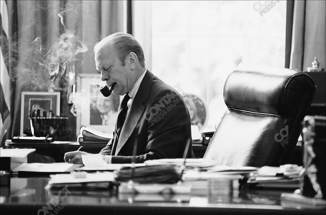 United States President Gerald Ford working in the Oval Office, White House, Washington, D.C., May 1976