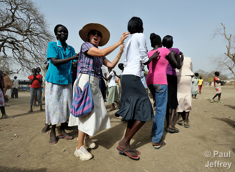 Sister Sandra Amado (in hat), a Comboni sister from Brazil, celebrates the end of a special teacher training course with her students in Agok, a town in the contested border region of Abyei between Sudan and South Sudan. Sister Amado is a volunteer with Solidarity with South Sudan, an international network of Catholic groups providing training for teachers, health care workers, and pastoral agents in South Sudan. The teachers she taught in Agok are among tens of thousands of people displaced in 2011 attacks by soldiers and militias from the northern Republic of Sudan. .
