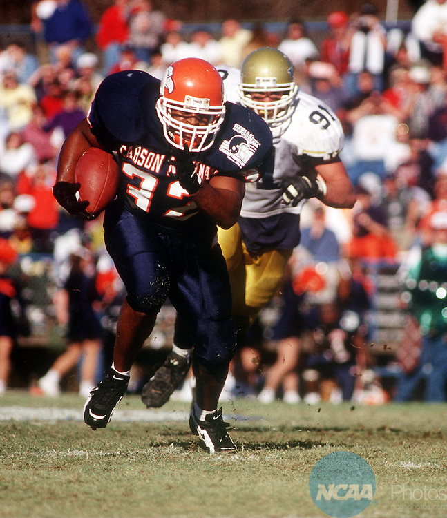 Caption: 14 Dec 1996: Carson-Newman running-back Wayne Morton (32) eludes University of Northern Colorado defensive-end Aaron Smith (91) during the Division 2 Men's Football Championship hosted by the University of North Alabama at Braly Municipal Stadium in Florence, AL... Northern Colorado defeated Carson-Newman 23-14 for the championship title. Josh Gibson/NCAA Photos.