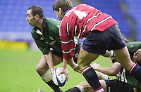 20/01/02 - Powergen  Cup - Quarter Final<br /> Madejski Stadium - Reading <br /> London Irish v Gloucester:<br /> Gloucester's Rob Fiddler keeps an eye on exiles  scrum half Henti Martens.[Mandatory Credit:Peter SPURRIER/Intersport Images]