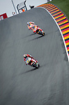 The rider Marc Marquez, Dani Pedrosa and Stefan Bradl during the MotoGP race at the Grand Prix Sachsenring in Germany. 13/07/2014. Samuel de Roman / Photocall3000
