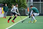 AMSTELVEEN - Nicky Leijs (Adam) met Albert Beltran (R'dam)   tijdens de hoofdklasse competitiewedstrijd heren, AMSTERDAM-ROTTERDAM (2-2). COPYRIGHT KOEN SUYK