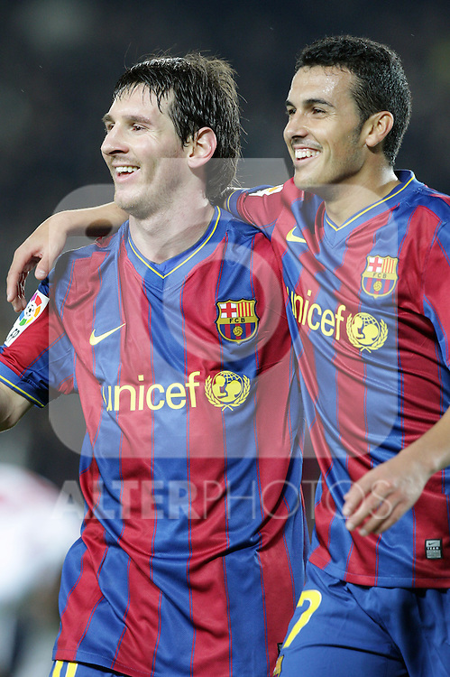 Football Season 2009-2010. Barcelona's player Lionel Messi (L) celebrates his goal with team-mate Pedro Rodriguez (R) during their spanish liga soccer match at Camp Nou stadium in Barcelona. January 16, 2010.