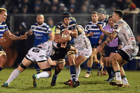 Paul Grant of Bath Rugby takes on the Gloucester Rugby defence. Premiership Rugby Cup match, between Bath Rugby and Gloucester Rugby on February 3, 2019 at the Recreation Ground in Bath, England. Photo by: Patrick Khachfe / Onside Images