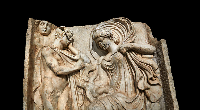 Close up of a Roman Sebasteion relief  sculpture of Anchises and Aphrodite Aphrodisias Museum, Aphrodisias, Turkey.   Against a black background.<br /> <br /> The Trojan shepherd Anchises gazes at the seated Aphrodite, his lover for one night on mount Ida. She hold a small Eros on her lap: this is an erotic encounter. The head of Selene (Moon) appears above the mountain rocks: she indicates night time. It was from this union that Aineas was born