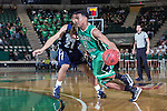 North Texas Mean Green guard Chris Jones (5) dribbles past Jackson State Tigers guard Phillip Williams (21)during the game between the Jackson State Tigers and the North Texas Mean Green at the Super Pit arena in Denton, Texas. UNT defeats Jackson State 83 to 65...