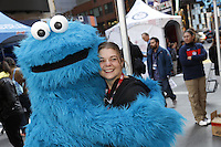 NEW YORK - OCT 29: Paralympic Snowboarder Heidi Jo Duce meets Cookie Monster. Olympic athletes participate in 100 Days to Sochi, a promotional event for the US Olympic Team, on Tuesday, October 29, 2013 in New York City. (Photo by Landon Nordeman)