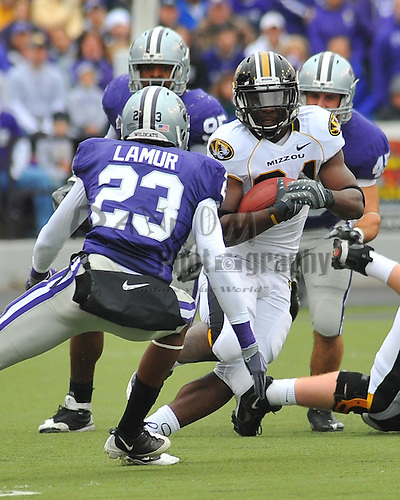 Nov 14, 2009; Manhattan, KS, USA; Missouri running back Derrick Washington (24) runs for yardage as Kansas State defensive back Emmanuel Lamur (23) attempts the tackle at Bill Snyder Family Stadium. The Tigers won 38-12. Mandatory Credit: Denny Medley-US PRESSWIRE