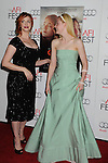 HOLLYWOOD, CA - NOVEMBER 07: Christina Hendricks and Elle Fanning arrive at the 'Ginger And Rosa' special screening during AFI Fest 2012 at Grauman's Chinese Theatre on November 7, 2012 in Hollywood, California.