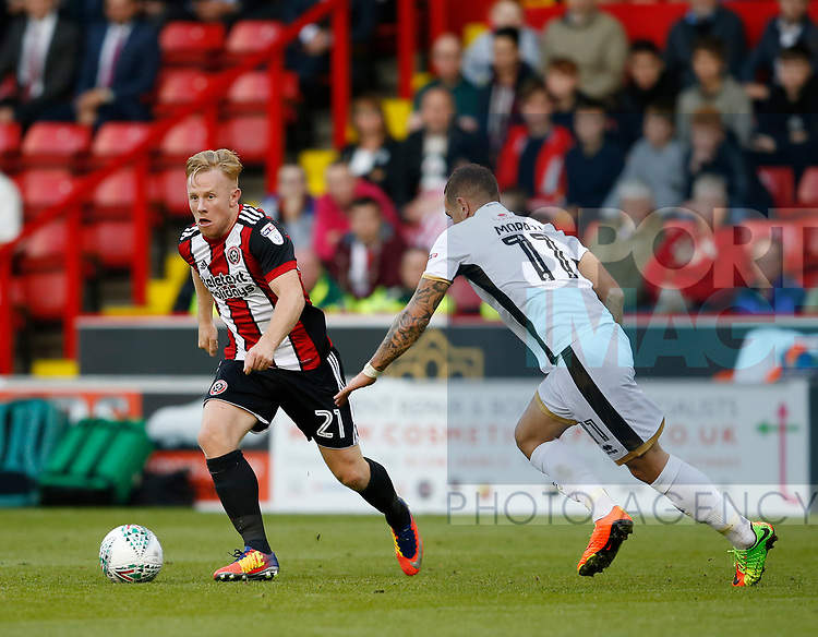 Mark Duffy of Sheffield Utd tussles with Kieron Morris of Walsall during the Carabao Cup First Round match at Bramall Lane Stadium, Sheffield. Picture date: August 9th 2017. Pic credit should read: Simon Bellis/Sportimage