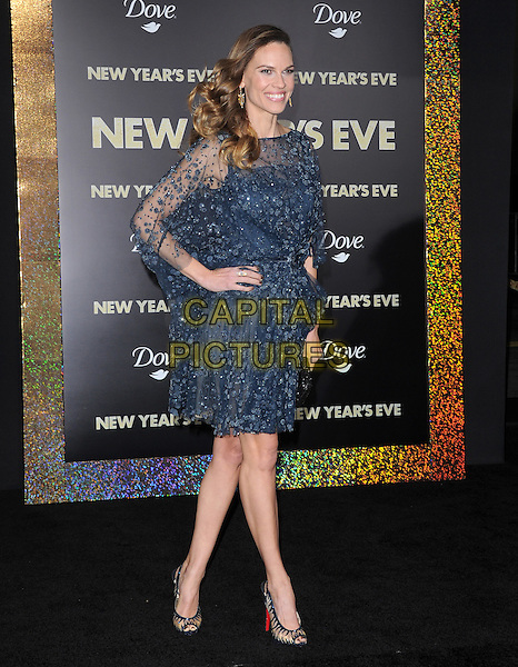 "Hilary Swank.The World Premiere of ""New Year's Eve' held at The Grauman's Chinese Theatre in Hollywood, California, USA..December 5th, 2011.full length dress black blue sheer beads beaded clutch bag silver peep toe shoes  hand on hip.CAP/RKE/DVS.©DVS/RockinExposures/Capital Pictures."