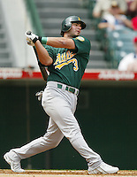 Eric Chavez of the Oakland Athletics bats during a 2002 MLB season game against the Los Angeles Angels at Angel Stadium, in Anaheim, California. (Larry Goren/Four Seam Images)