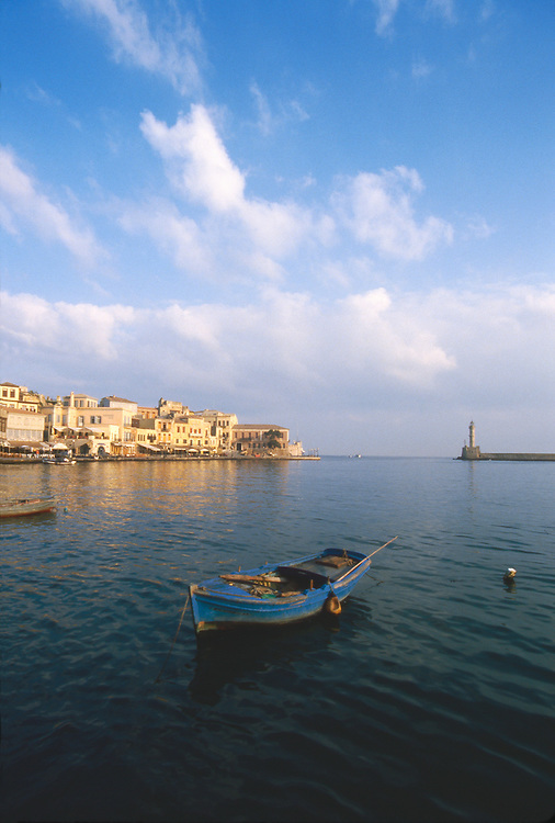 Crete, Greece, Chania, Khania, harbor, seawall, lighthouse, Venetian architecture, classic Mediterranean town on the Northwest coast of Crete,.