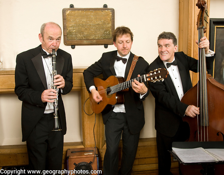 Jazz trio play wearing formal clothes