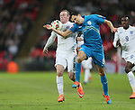England's Wayne Rooney tussles with Slovenia's Branko Ilic<br /> <br /> - International European Qualifier - England vs Slovenia- Wembley Stadium - London - England - 15th November 2014  - Picture David Klein/Sportimage