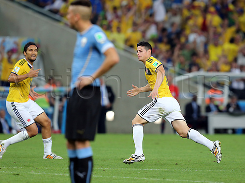 28.06.2014. Rio De Janeiro, Brazil. World Cup 2nd Round. Colombia versus Uruguay. James Rodriguez turns to celebrates with team mates after his goal for 1-0