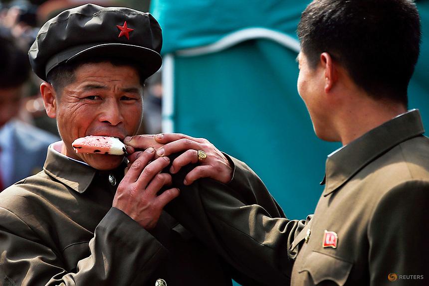 Men share an ice-cream in Pyongyang, North Korea April 16, 2017.    REUTERS/Damir Sagolj