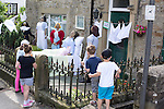 """Scarecrow Festival at Kettlewell in Yorkshire 2013<br /> <br /> House next door to the Kettleworth Stores had an impressive """"Call The Midwife"""" display of scarecrows.<br /> <br /> <br /> <br /> Scarecrows are made by local community and places in and around their front gardens.  Competition is fierce but it's all to raise money  for the local church  and other local projects to benefit the whole community.<br /> <br /> <br /> <br /> Picture by Gavin Rodgers/ Pixel 8000 <br /> <br /> 07917221968"""