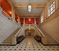 One of the large double staircases in the hall of the Maison Internationale or International House, designed by Lucien Bechmann, 1880-1968, and Jean-Frederic Larson, and opened in 1936, in the Cite Internationale Universitaire de Paris, in the 14th arrondissement of Paris, France. The CIUP or Cite U was founded in 1925 after the First World War by Andre Honnorat and Emile Deutsch de la Meurthe to create a place of cooperation and peace amongst students and researchers from around the world. It consists of 5,800 rooms in 40 residences, accepting another 12,000 student residents each year. Picture by Manuel Cohen. Further clearances may be requested.