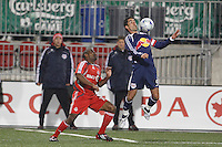 New York Red Bulls forward Juan Pablo Angel (9) plays the ball in front of Toronto FC defender Marvell Wynne (16). Toronto FC and the New York Red Bulls played to a 1-1 tie during a Major League Soccer match at BMO Field in Toronto, Ontario, Canada, on May 1, 2008.