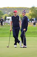 Daniel Berger (USA) and Justin Thomas (USA) chat on 16 during round 3 Four-Ball of the 2017 President's Cup, Liberty National Golf Club, Jersey City, New Jersey, USA. 9/30/2017.<br /> Picture: Golffile | Ken Murray<br /> <br /> All photo usage must carry mandatory copyright credit (&copy; Golffile | Ken Murray)