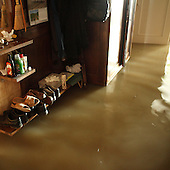 NOWY WIONCZENIN, POLAND, MAY 24, 2010:.Flooded house of Krystyna Ciastek..The latest chapter of disastrous floods in Poland has been opened yesterday, May 23, 2010, after Vistula river broke its banks and flooded over 25 villages causing evacualtion of most inhabitants..Photo by Piotr Malecki / Napo Images..NOWY WIONCZENIN, POLSKA, 24/05/2010:.Zatopiony dom Krystyny Ciastek.  Najnowszy akt straszliwych tegorocznych powodzi zostal rozpoczety wczoraj gdy Wisla przerwala waly na wysokosci wsi Swiniary kolo Plocka..Fot: Piotr Malecki / Napo Images ..