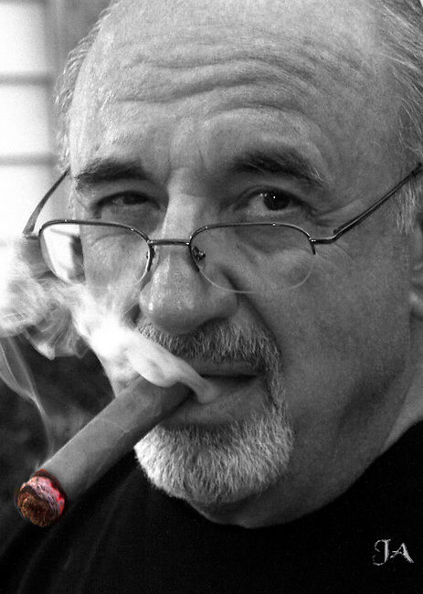 Man with cigar and red hot glowing tip.  The color of the tip has NOT been enhanced.
