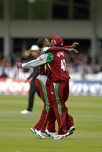 1 July 2007: West Indies all-rounder Dwayne Bravo celebrates catching A Cook with bower Fidel Edwards during the first Natwest series one day International between England and West Indies at Lords. England won the match by 79 runs Photo: Neil Tingle/Action Plus...070701 cricket cricketer joy celebration