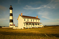 With its well-preserved light keepers house and outbuildings, the stately Bodie Island Lighthouse is a strikingly beautiful classic coastal lighthouse, located on Bodie Island on North Carolina's Outer Banks. The light house, built in 1872, stands 156 feet tall and is located on the Roanoke Sound side of the first island that is part of the Cape Hatteras National Seashore. The lighthouse is just south of Nag's Head, a few miles before Oregon Inlet. The conical-shaped lighthouse has white and black bands with a black lantern house. Charlotte NC photographer Patrick Schneider has extensive photo collections of the following lighthouses: Bodie Island Lighthouse, Bald Head Island Lighthouse, Cape Fear Lighthouse, Cape Hatteras Lighthouse, Cape Lookout Lighthouse, Currituck Beach Lighthouse, Diamond Shoal Lighthouse, Federal Point Lighthouse, Oak Island Lighthouse, and Ocracoke Lighthouse on Ocracoke Island.