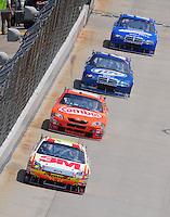 Jun 1, 2008; Dover, DE, USA; NASCAR Sprint Cup Series driver Greg Biffle (16) leads Kyle Busch (18), Kurt Busch (2) and Ryan Newman (12) during the Best Buy 400 at the Dover International Speedway. Mandatory Credit: Mark J. Rebilas-US PRESSWIRE