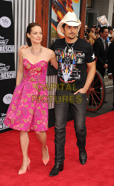 HOLLYWOOD, CA- JULY 15: Actress Kimberly Williams-Paisley (L) and husband singer Brad Paisley arrive at the Los Angeles premiere of Disney's 'Planes: Fire &amp; Rescue' at the El Capitan Theatre on July 15, 2014 in Hollywood, California.<br /> CAP/ROT/TM<br /> &copy;Tony Michaels/Roth Stock/Capital Pictures