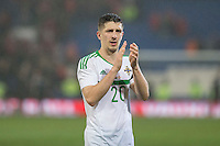 Goalscorer Craig Cathcart of Northern Ireland thanks the travelling fans at full time during the International Friendly match between Wales and Northern Ireland at Cardiff City Stadium, Cardiff, Wales on 24 March 2016. Photo by Mark  Hawkins / PRiME Media Images.
