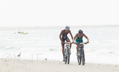 13 JUL 2013 - DEN HAAG, NED - Ben Allen (AUS) (right) of Australia leads Brice Daubord (FRA) (left) of France along the beach during the bike at the 2013 ITU Elite Men's Cross Triathlon World Championships in Kijkduin, Den Haag (The Hague), the Netherlands (PHOTO COPYRIGHT © 2013 NIGEL FARROW, ALL RIGHTS RESERVED)