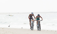 13 JUL 2013 - DEN HAAG, NED - Ben Allen (AUS) (right) of Australia leads Brice Daubord (FRA) (left) of France along the beach during the bike at the 2013 ITU Elite Men's Cross Triathlon World Championships in Kijkduin, Den Haag (The Hague), the Netherlands (PHOTO COPYRIGHT © 2013 NIGEL FARROW, ALL RIGHTS RESERVED)